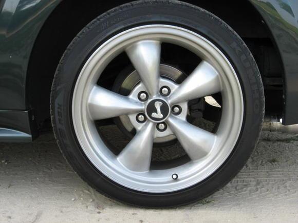 """18x9"""" Aluminum Bullitt rims wrapped in Kumho tires"""