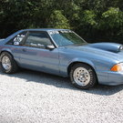 90 MUSTANG LX BRACKET CAR-ROLLER