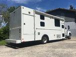 GMC (w/ 25,000 mi) Toter Home / Hauler / Coach (IN DAYTONA)