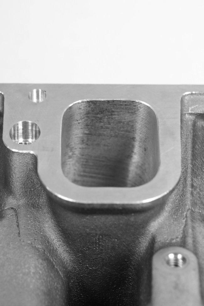 Katech CNC machine LT4 supercharger bolt holes into LT1