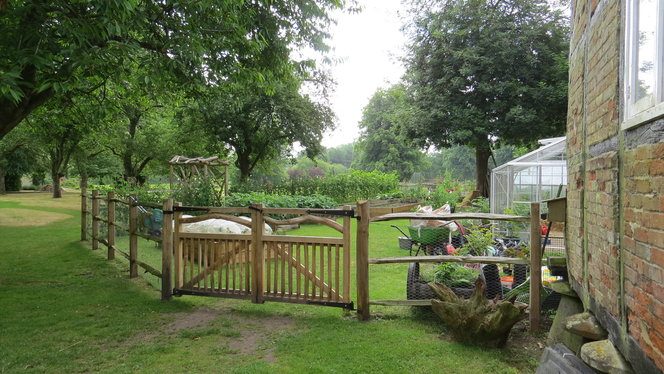 We were asked to build a small vegetable garden using natural timber for the fence, gates and garden arch. All the wood was Sweet Chestnut green, gate furniture was forged by local blacksmith