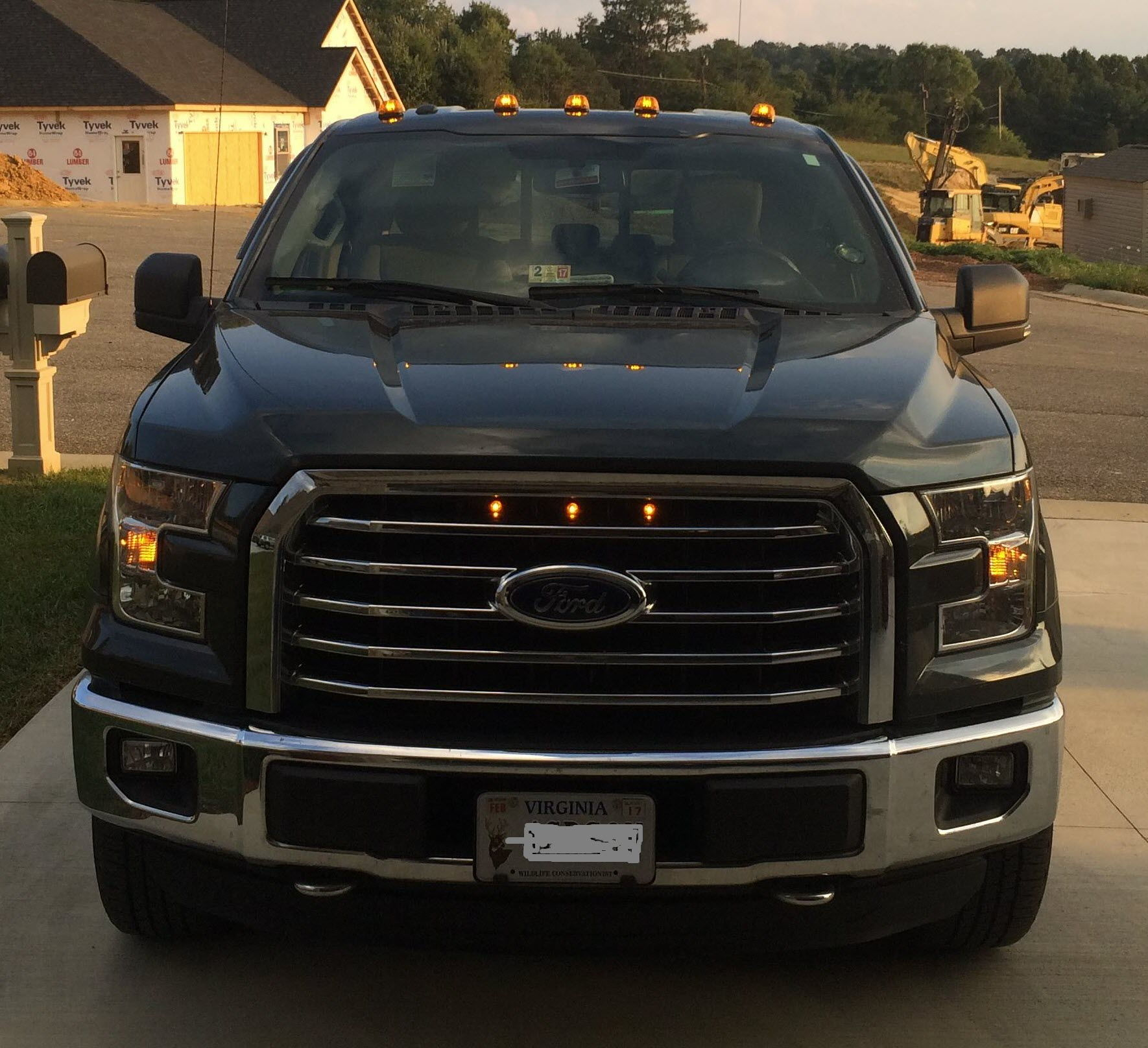 Here Is My 2015 F150 With Raptor Grille Lights And LED Roof Marker Lights.