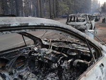 People fleeing the Camp Fire in Paradise, Calif., abandoned their vehicles because of traffic; their cars remained along the road on Sunday.CreditCreditJim Wilson/The New York Times