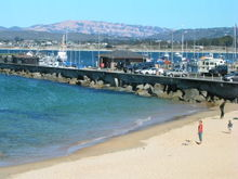 Monterey Coast Guard pier and Mount Toro