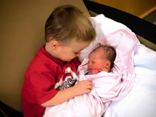 "Big brother holding ""his baby"" for the first time"