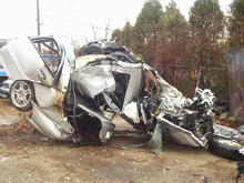 C32, post 80 mph flight into a tree.  The driver lived.