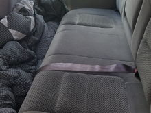 rear bench seat. Always covered with a comforter for the dogs comfort.