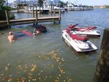 Jeep is still rolling down ramp, so Skinhead #2 abandons jet ski's and tries to pull jeep up ramp.