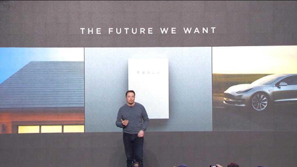 Tesla Solar Battery >> Tesla Debuts Bigger Powerwall 2 0 Battery Glass Solar Roof Tiles