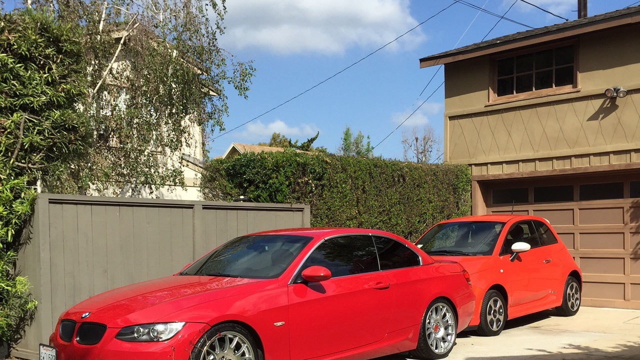 2007 BMW 335i and 2015 Fiat 500e electric car in driveway, May 2015  [photo: Chris Baccus]