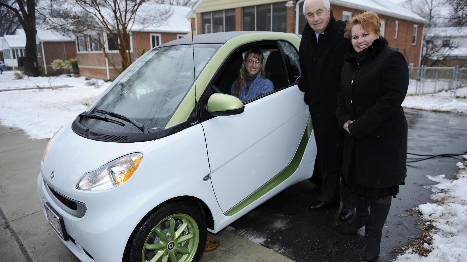 First Smart ForTwo Electric Drive with Roger Penske and Smart USA president Jill Lajdziak, Jan 2011