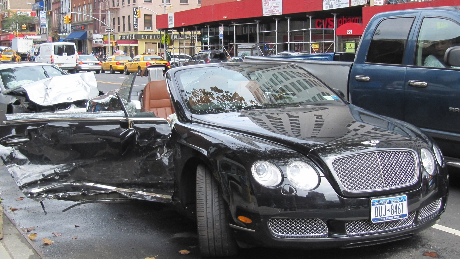 Wrecked Bentley Continental GTC parked at the side of the street in New York City