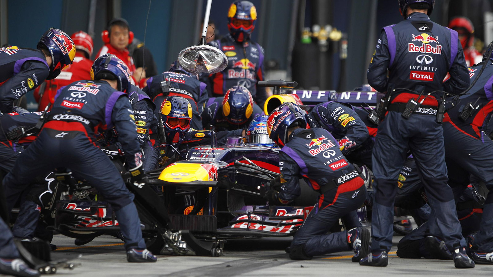 The Red Bull Racing Formula One team executes a pit stop