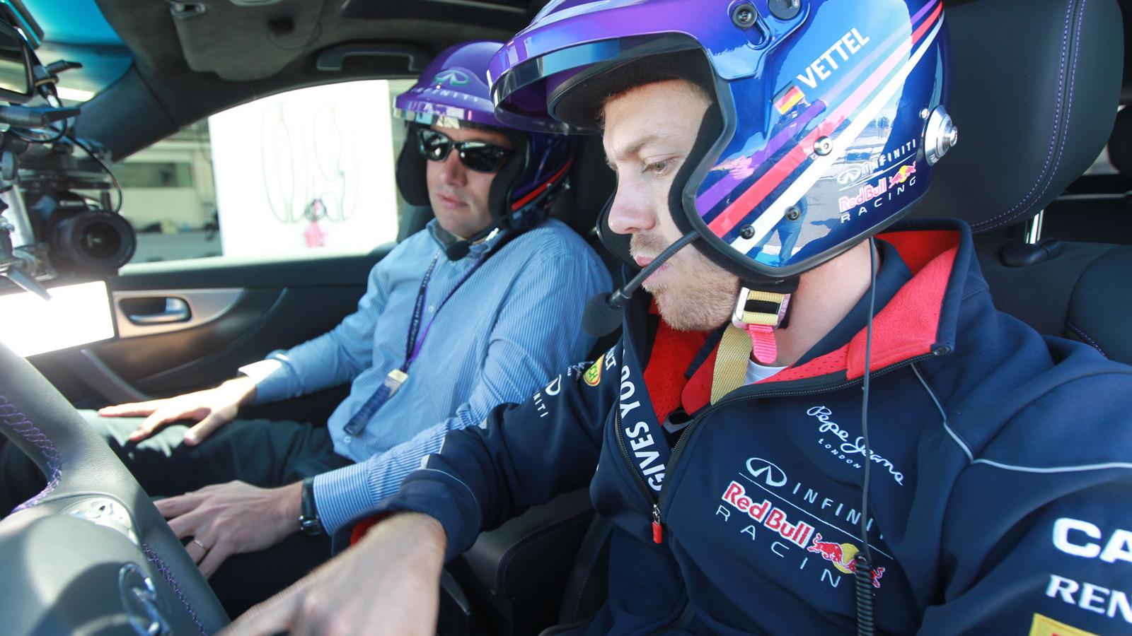 Sebastian Vettel with Infiniti engineering team