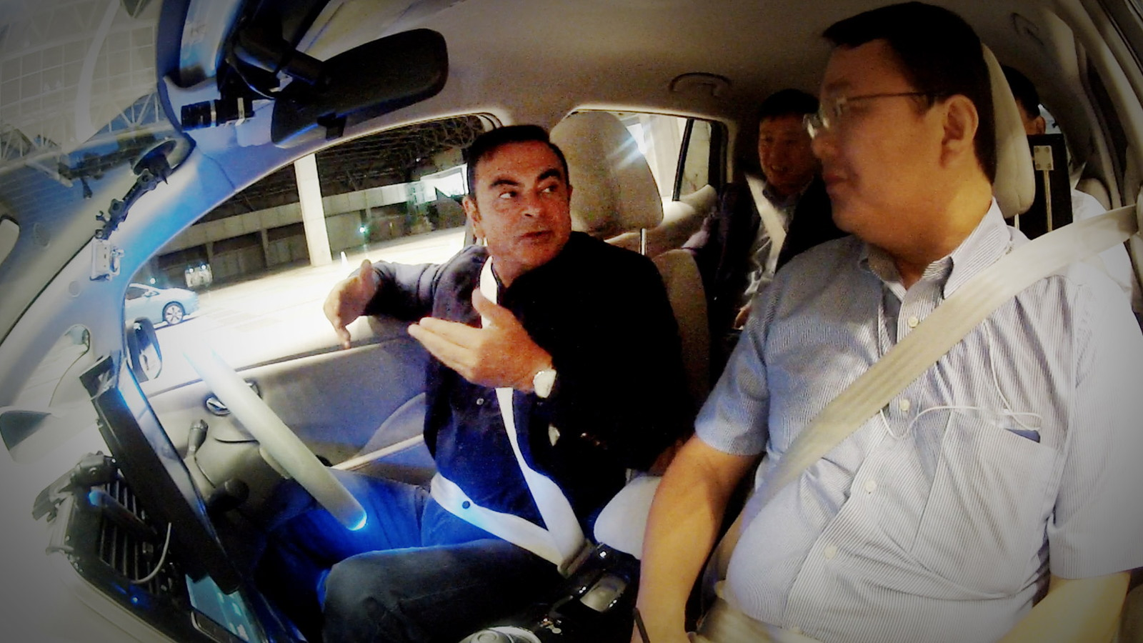 Renault Nissan CEO Carlos Ghosn in a Nissan Leaf autonomous car prototype