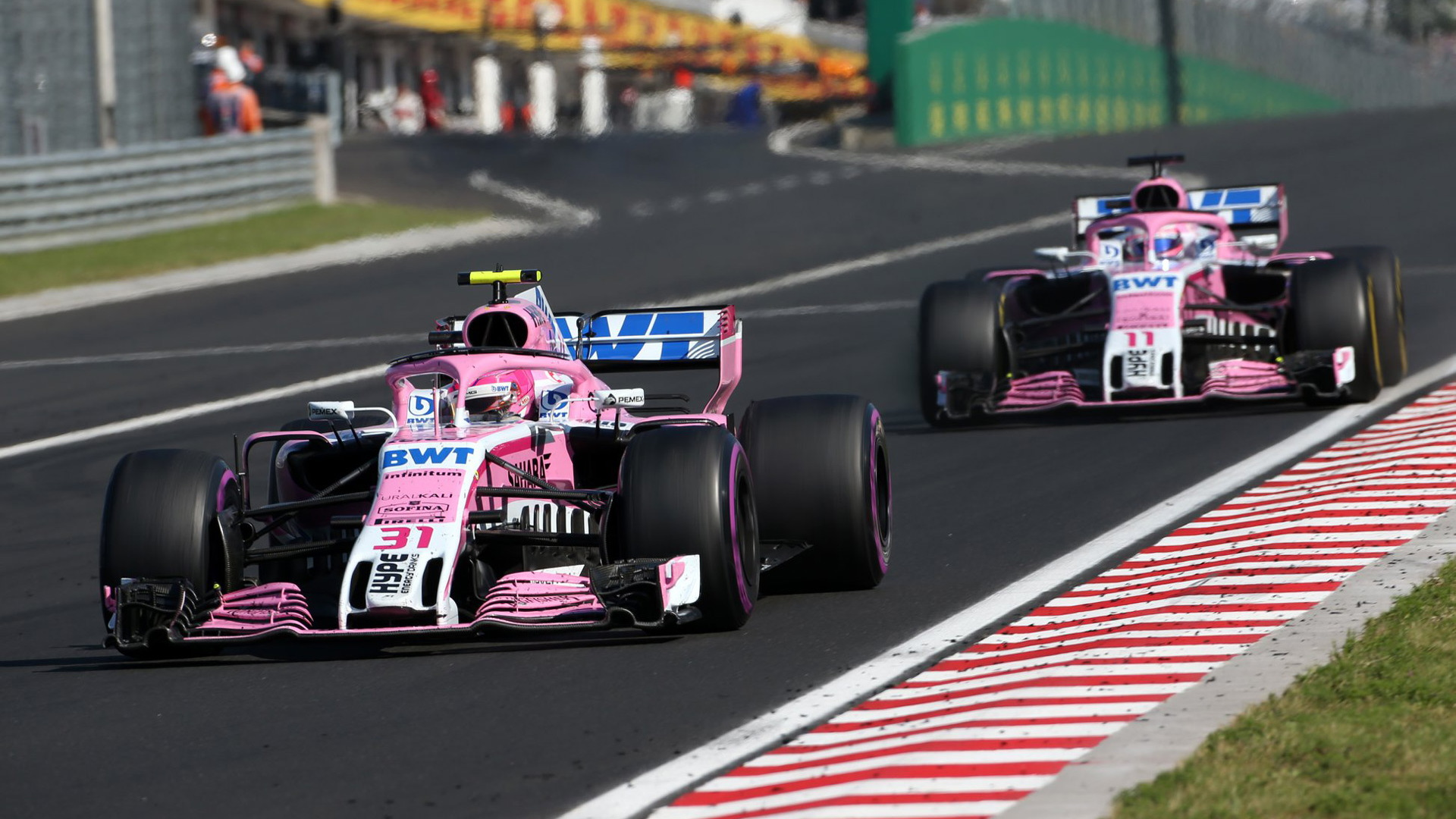 Force India's Esteban Ocon and Sergio Perez at the 2018 Formula 1 Hungarian Grand Prix