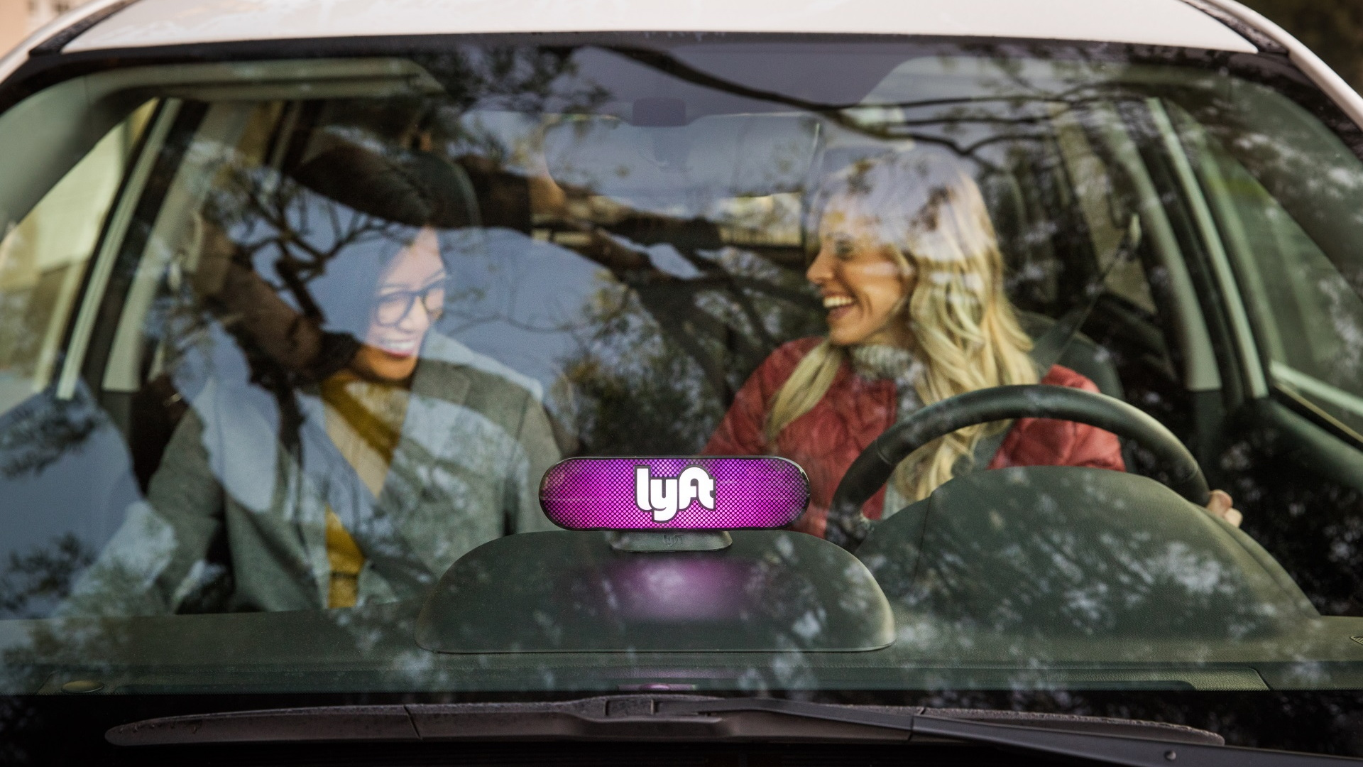 Lyft car picking up a rider