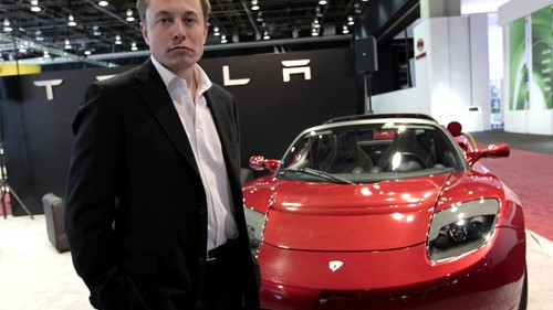Tesla Motors CEO Elon Musk with Tesla Roadster
