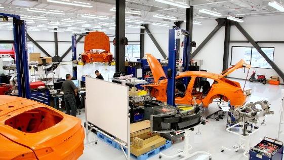 Tesla Model S workshop - cars to be crash-tested are painted orange