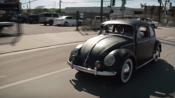 An original 1955 VW Beetle swings by Jay Leno's Garage