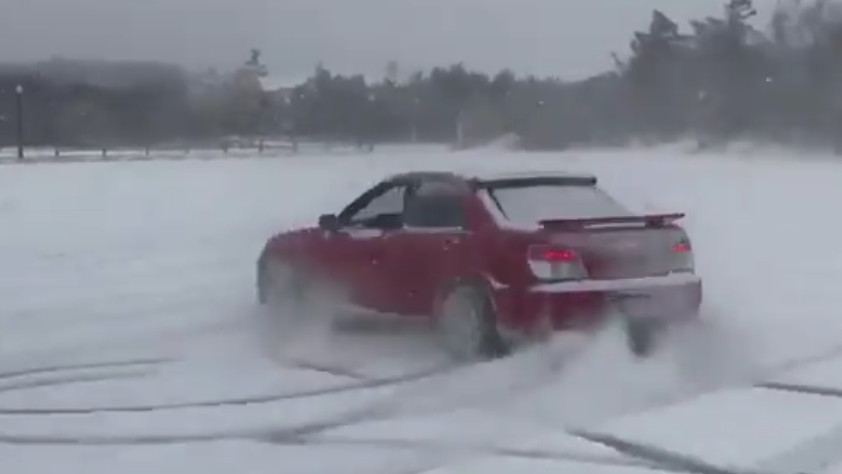 Ansel Elgort, aka Baby Driver, drifts his Subaru WRX in the snow