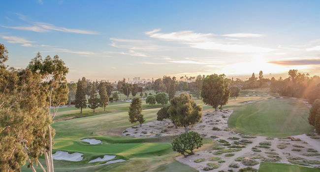 Bordered by the greens of the Wilshire Country Club