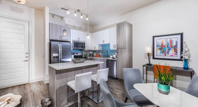 Mist kitchen design package with blue backsplash, tuxedo style cabinets in polished white and gray