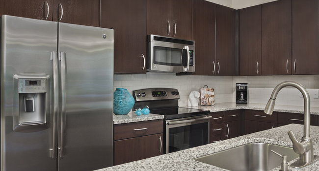 Kitchens with granite counters, subway tile backsplash and side-by-side stainless steel refrigerator with exterior ice/water dispenser
