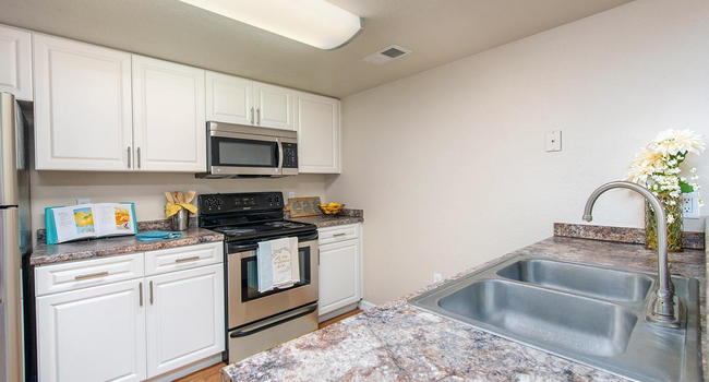 Upgraded kitchens, fully equipped with stainless steel appliances and a laundry room.