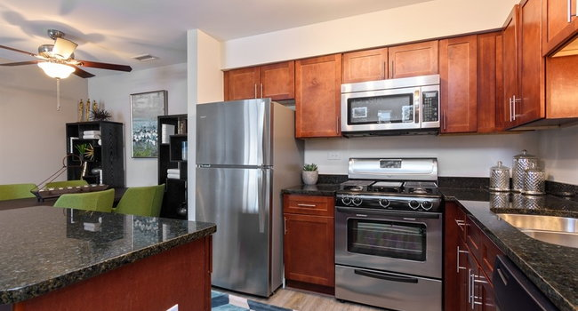Large open kitchen with granite countertops and stainless-steel appliances
