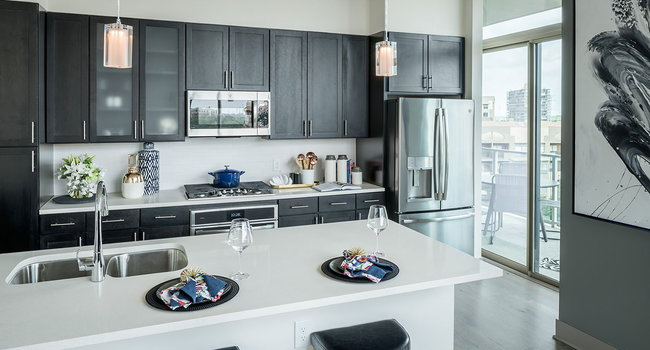Kitchen features Contemporary Wood Cabinetry and Under Cabinet Lighting